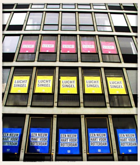 The posters promoting the proposal of Luchtsingel in the first of three stadsinitiatief (eng. city initiative) programs organized in Rotterdam in 2012 presented in the windows of the Schieblock. The Stadsinitiatief was a program of the municipality of Rotterdam where one project to improve the city was chosen through a public vote. The Luchtsingel was the first of the program's winners. Image courtesy of ZUS.
